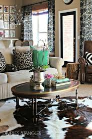 Rug Under Dining Room Table by The 25 Best Cowhide Rug Decor Ideas On Pinterest Cowhide Rugs