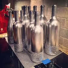 silver wine bottles variety of different size wine bottles spray painted metallic