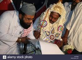 muslim and groom muslim groom signs nikaahnaama marriage certificate tamil