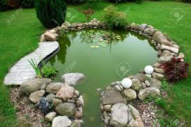 beautiful classical design garden fish pond in a well cared