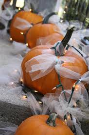 outdoor fall decoration using pumpkins tulle and christmas lights