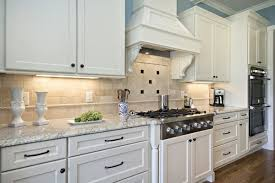 What Color Granite Goes With White Cabinets by White Cabinets Bianco Romano Granite Countertop Tile Backsplash