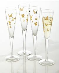 four gold butterfly chagne flutes