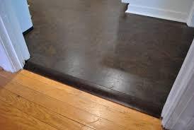 metal transition between hardwood flooring and tile meze