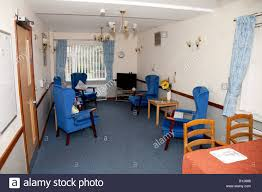 an empty lounge in an elderly nursing care home england uk stock