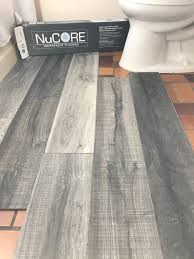 Can Laminate Flooring Be Used In Bathrooms Vinyl Plank Flooring That U0027s Waterproof Lays Right On Top Of Your