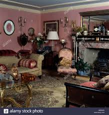 Victorian Style Living Room Dark Pink Sofa In Victorian Style Living Room With Gilt Mirror