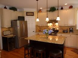 traditional kitchen with simple granite counters by dayne luck