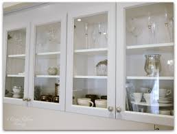 upper cabinets with glass doors new kitchen update integrated hood upper cabinets classy glam