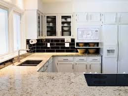 stone tile kitchen backsplash with granite countertops marissa