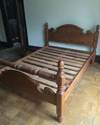 solid pine kingsize bed frame with head board and footboard in