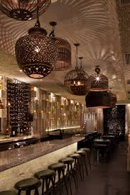 the palmilla restaurant bar s eclectic fixtures cast beautiful interiors