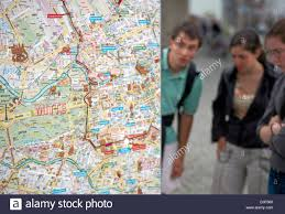 Map Of Berlin Germany by Berlin Germany Tourists Look At A City Map Of Berlin Stock Photo