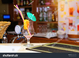 martini glass with umbrella empty glass cocktail umbrella straw orange stock photo 432232168