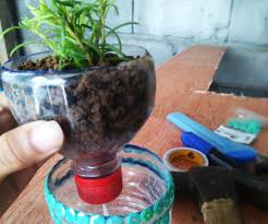 upcycled plastic bottle into self watering planter 6 steps
