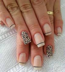 and white leopard nail art design with french tips