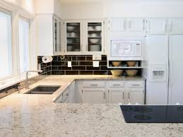 white kitchen cabinets with backsplash white granite countertops hgtv