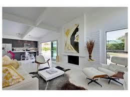 black marble saarinen dining table white walls open concept modern