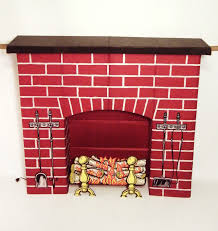 omg yes a fake fireplace made of corrugated cardboard and yes