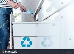 modern kitchen bins smart person sorting waste modern kitchen stock photo 709344985