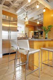 exposed ceiling basement kitchen transitional with white barstool