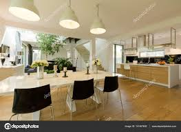 dining room with white table and black chairs u2014 stock photo