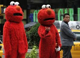 mitt romney halloween costume 2012 two people dressed in knockoff elmo costumes wait to pose