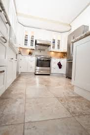 white kitchen cabinets with tile floor kitchen remodel photos classic home improvements kitchen