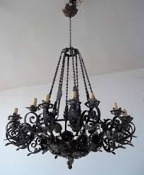 Vintage Wrought Iron Chandeliers Black Vintage Wrought Iron Chandelier Hung In The White Ceiling