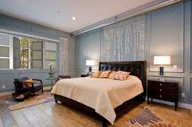 wainscoting bedroom ideas tropical master bedroom with exposed beam by square one interiors