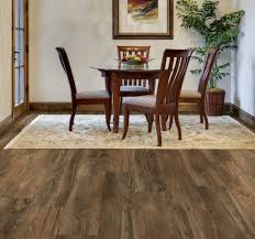 dining room flooring ideas walnut allure vinyl plank flooring matched with white wall plus