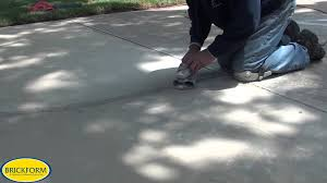 Leveling Uneven Concrete Patio by How To Resurface Cracked Concrete With Brickform Overlay Youtube