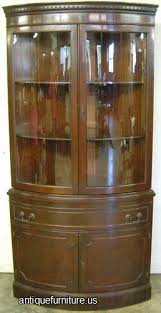 antique mahogany curved glass double door corner cabinet at