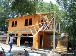 Building A Garage Apartment by A Tangerine Carriage House Designed By Historic Shed