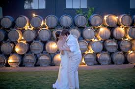 wedding backdrop cost string lights through barrels at a winery for a no cost photo
