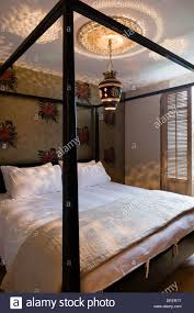 a room with a four poster bed in the wordsworth hotel grasmere