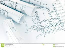 rolls of architecture blueprints with floor plan drawing on arch