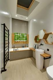 house tour a trendy minimalist apartment with a green wall and