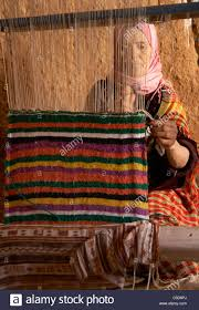 Tunisian Rug Travel Tunisia Berber Woman Weaving A Traditional Rug At An Stock