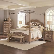 king canopy bed with mirror back headboard by coaster wolf and