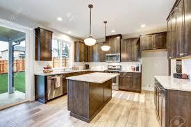 kitchen backsplash with light brown cabinets light filled northwest kitchen design with kitchen island