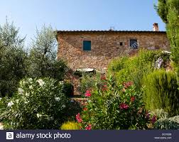 Tuscany House by Traditional Stone House In A Hamlet In Tuscany Italy Stock Photo