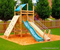 A Slide Rock Wall And Draw Bridge Just Needs A Firemans Pole - Backyard playground designs