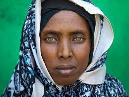 portrait of an afar tribe woman with green eyes and tattoo u2026 flickr