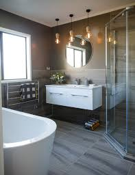 bathroom reno from peach cabinetry to sophisticated and sleek