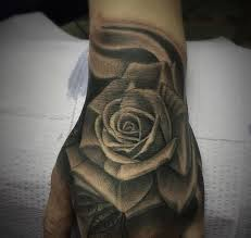 custom black and grey rose hand tattoo by salvador diaz at