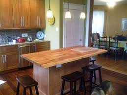 kitchen island table with varnished wooden butcher block top and