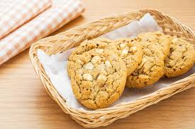 cookie basket white chocolate chip with raspberry cookie in basket stock photo