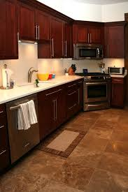 Shaker Cherry Kitchen Cabinets Brown Countertops Wood Floors And - Kitchen with cherry cabinets