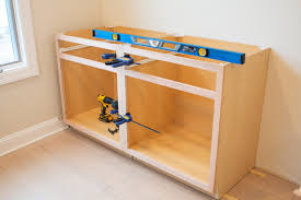 how to build a base for cabinets to sit on how to install diy built in cabinets the diy playbook